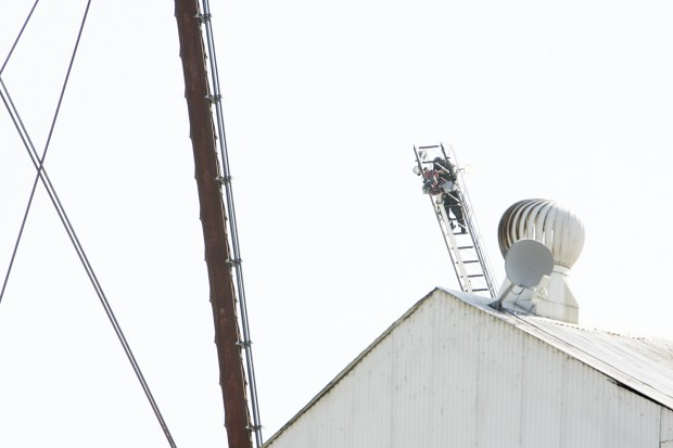 Man climbs water tower and resists help