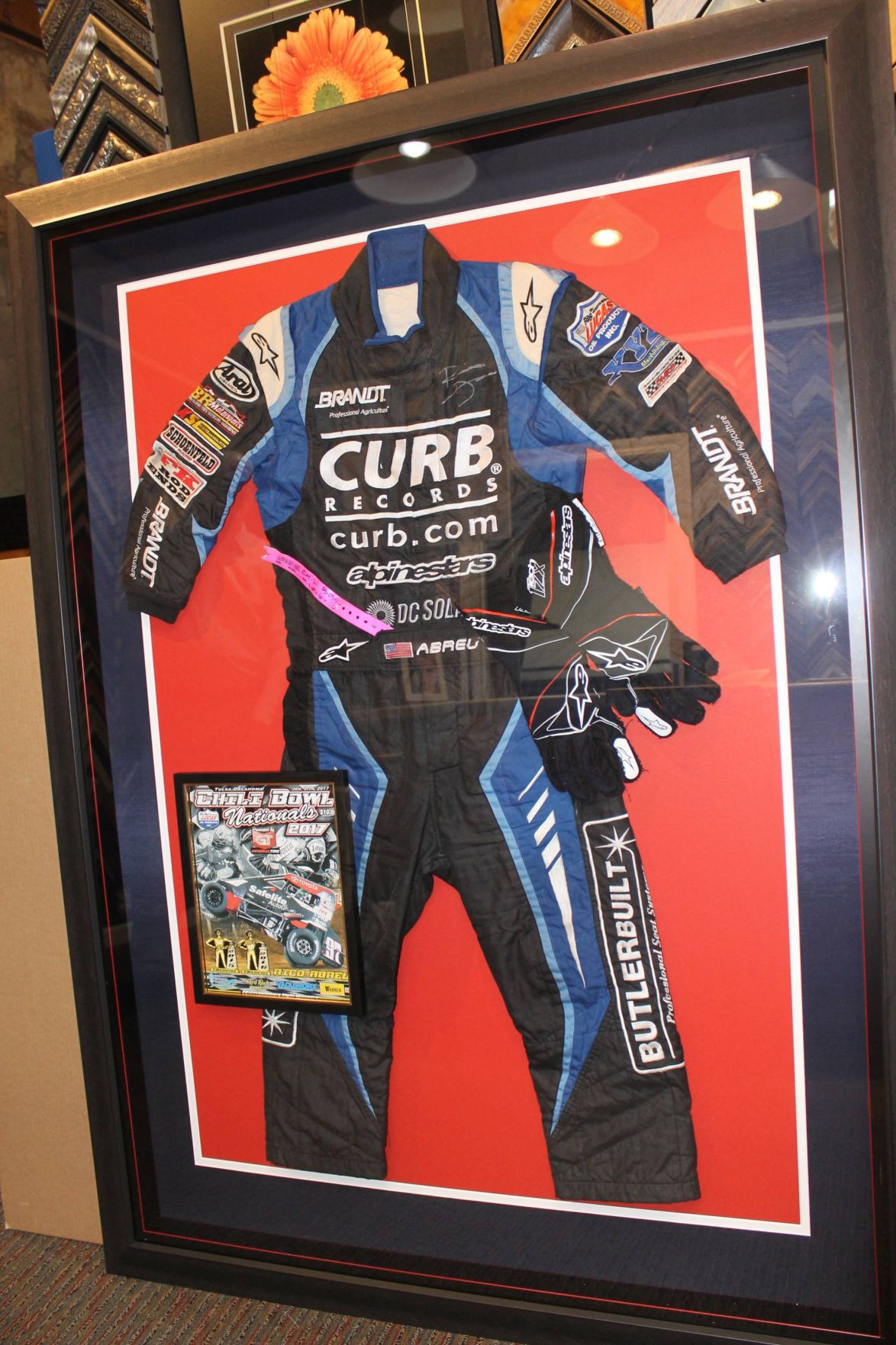 Rico Abreu's Sprint car suit, framed by Alan Fowler
