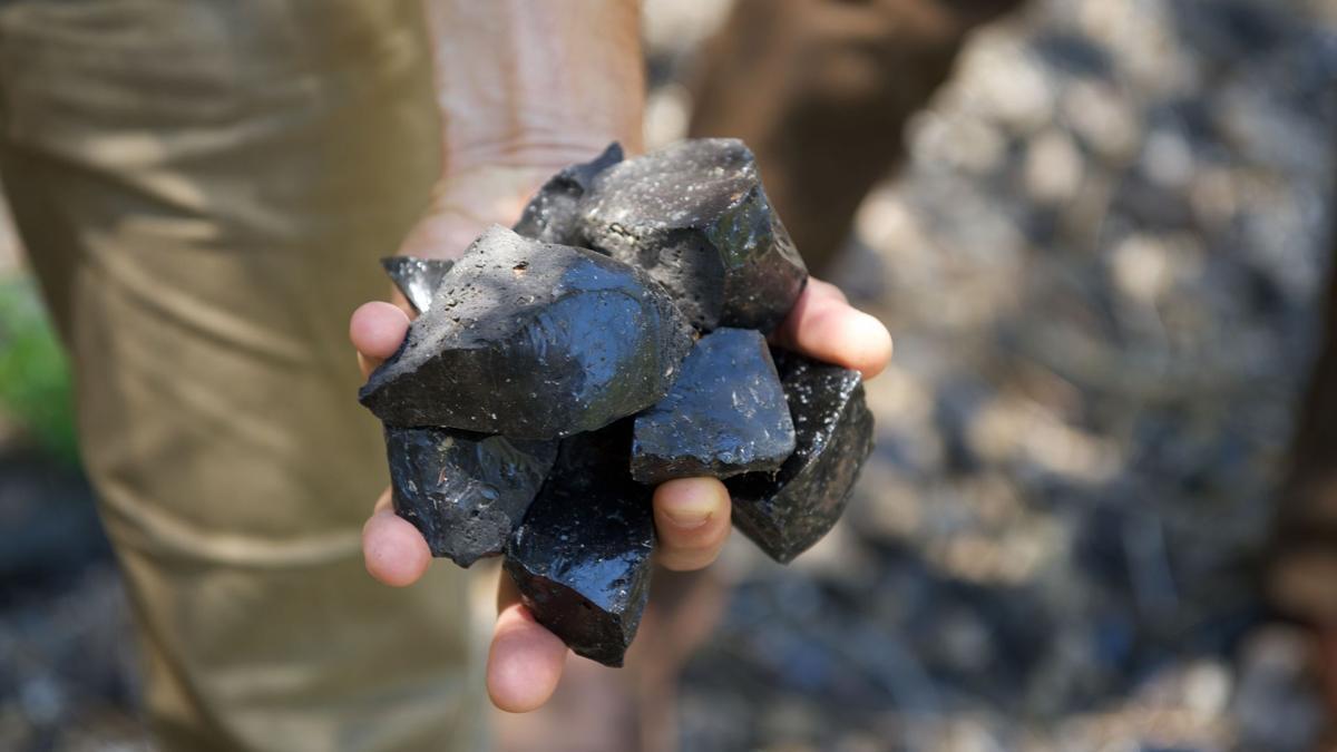 Obsidian Rock in Hand