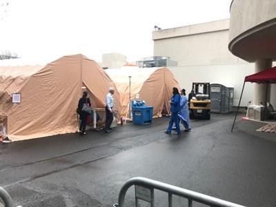 Queen coronavirus triage tents