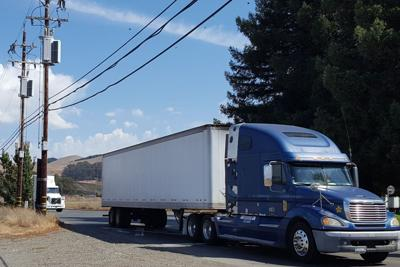 Utility poles and commercial truck on Green Island Road