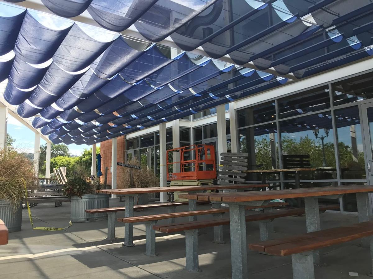 Oxbow Public Market river deck with awning