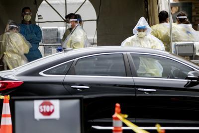 US-NEWS-RECORD-DAY-OF-CORONAVIRUS-DEATHS-LA.jpg