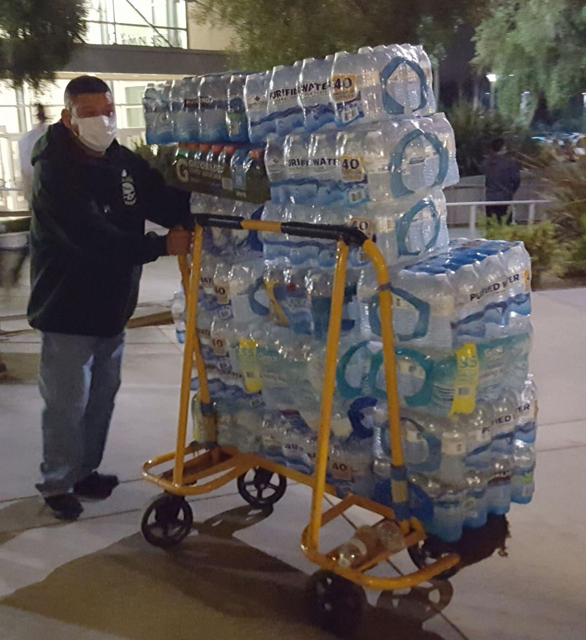 Volunteer wheels in water at American Canyon evacuation center