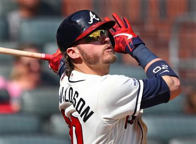 The Atlanta Braves' Josh Donaldson hits a three-run home run against the Colorado Rockies on April 28, 2019, at SunTrust Park in Atlanta.