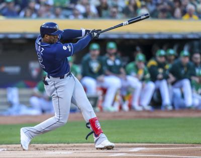 The Tampa Bay Rays' Yandy Diaz connects for a solo home run in the first inning against the Oakland Athletics in the American League Wild Card game on October 2, 2019, at the Oakland Coliseum in Oakland, Calif.