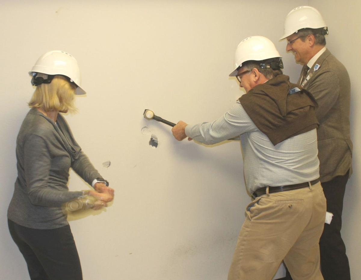 Breaking down the sheetrock at Adventist Health St. Helena