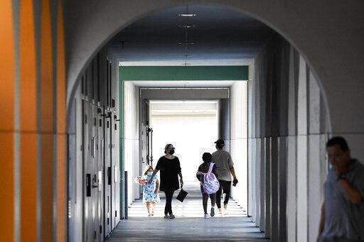 Hugs as California public school returns to class in person