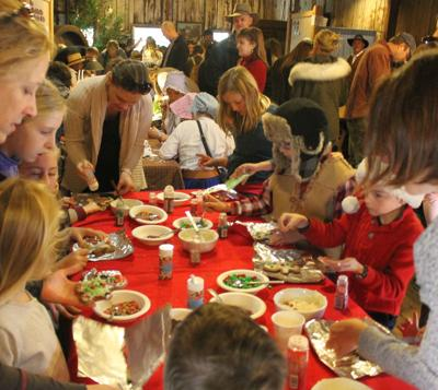 Busy hands decorating gingerbread men at the Bale Grist Mill