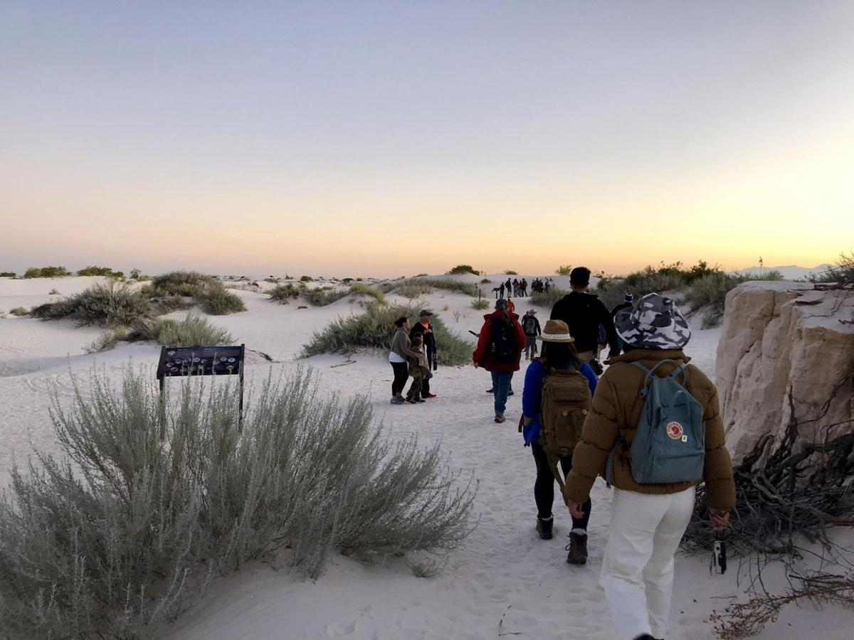 Trekkers make their way through White Sands on a full moon hike in October.