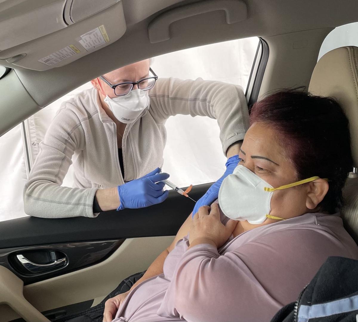Dr. Zita Konik vaccinates Dolores Hernandez.jpg