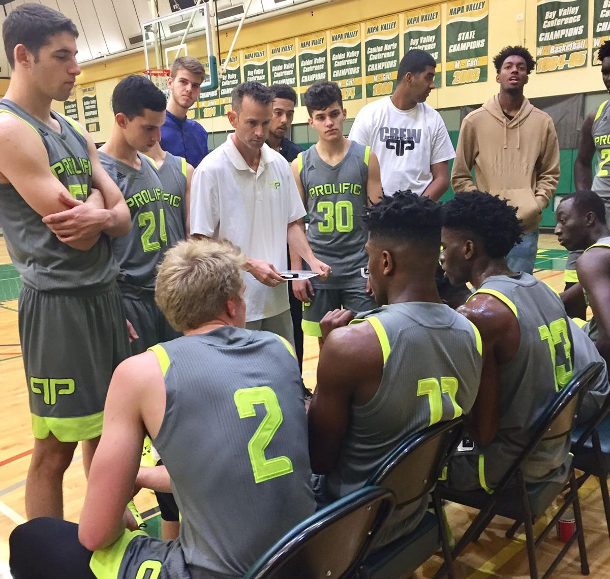 prolific prep head coach billy mcknight speaks to his team during a timeout on sunday against the simpson university jv squad from redding