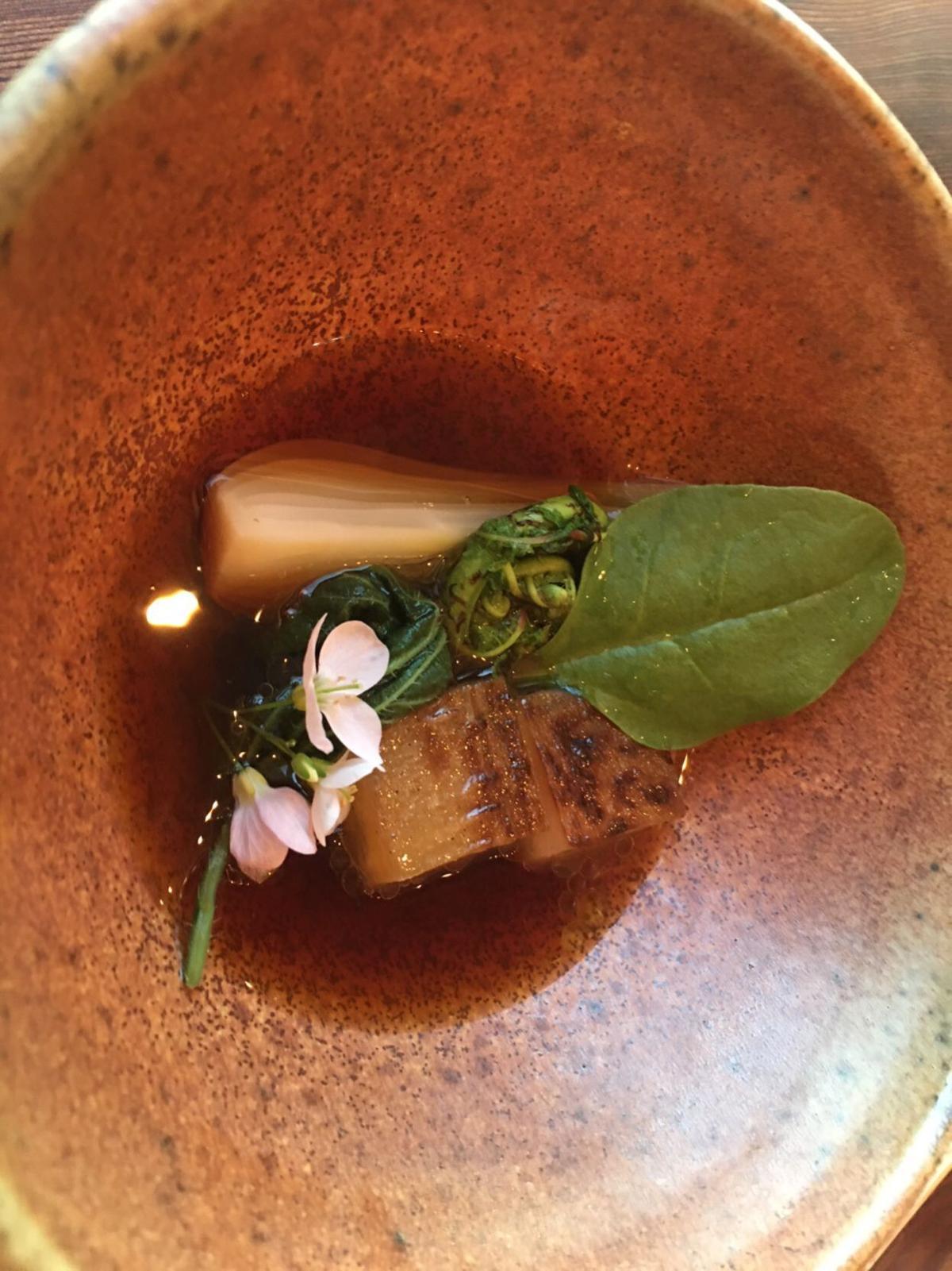 Spring vegetables in red daikon poaching liquid