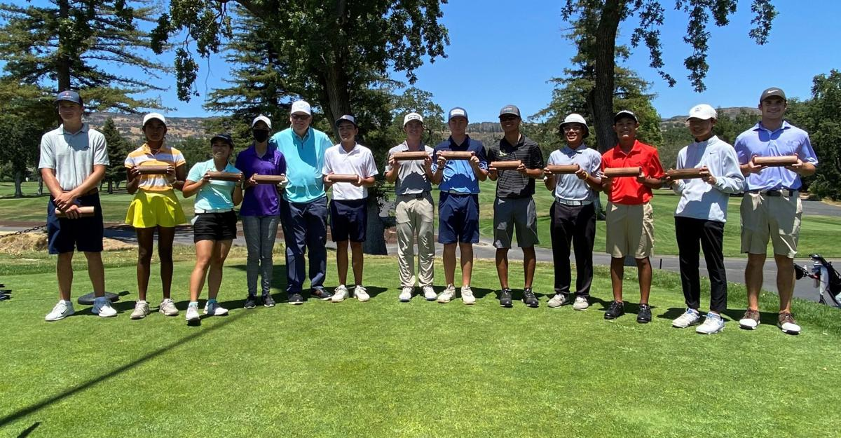 """Johnny Miller poses with age-group winners of his """"Champ"""" Junior Classic"""