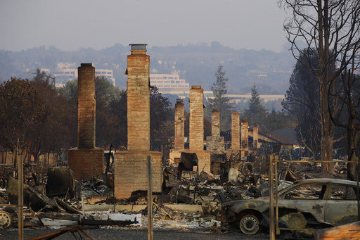 The Latest: California prepares to clean up wildfire waste