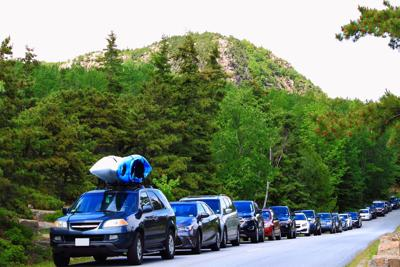 Cars line up to visit Acadia National Park in Maine.