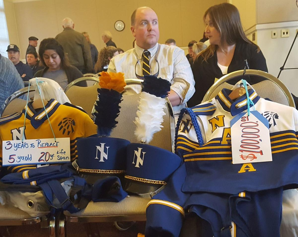 Napa High band director Mike Riendeau with band uniforms
