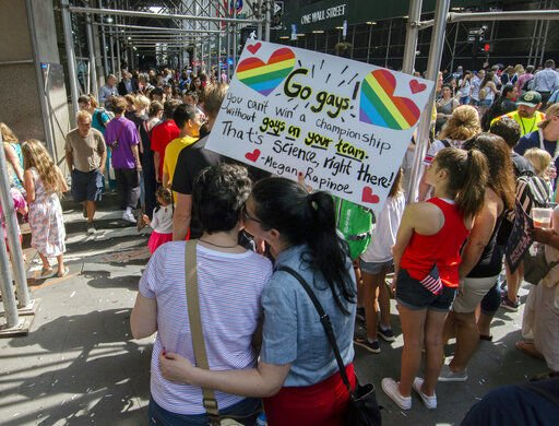 Fans celebrate World Cup champs, rally for equal pay