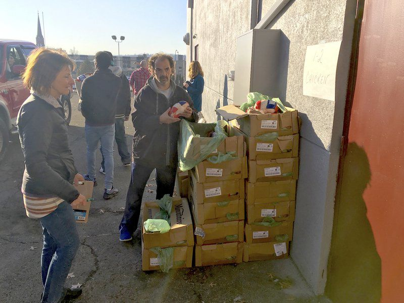Mission shares holiday meals 300 families take home the makings of Thanksgiving feast