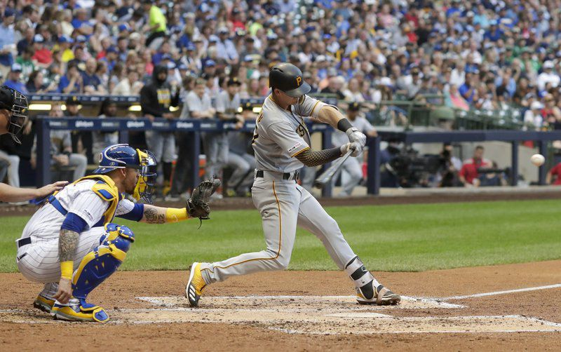 Newman homers, Pirates rally late to beat Brewers