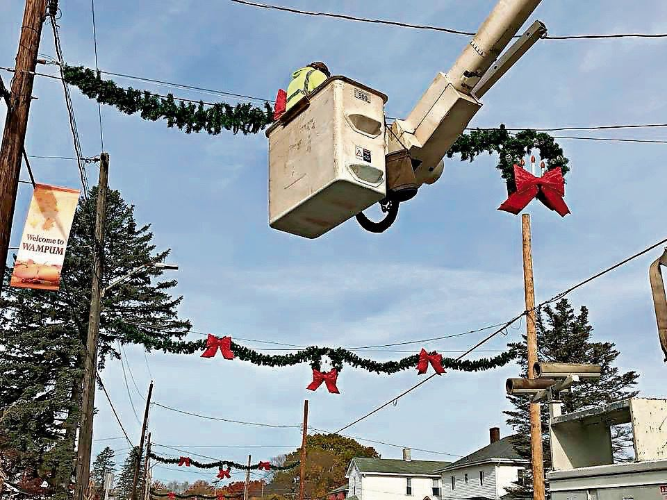 wampum borough workers finish installing the new christmas decorations and lights that replace ones that are 40 to 50 years old