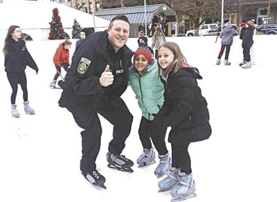 Skating with a hero: Local youth take to the ice with first responders