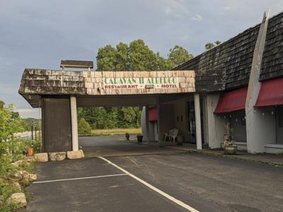 Glitch delays tax sale of former hotel