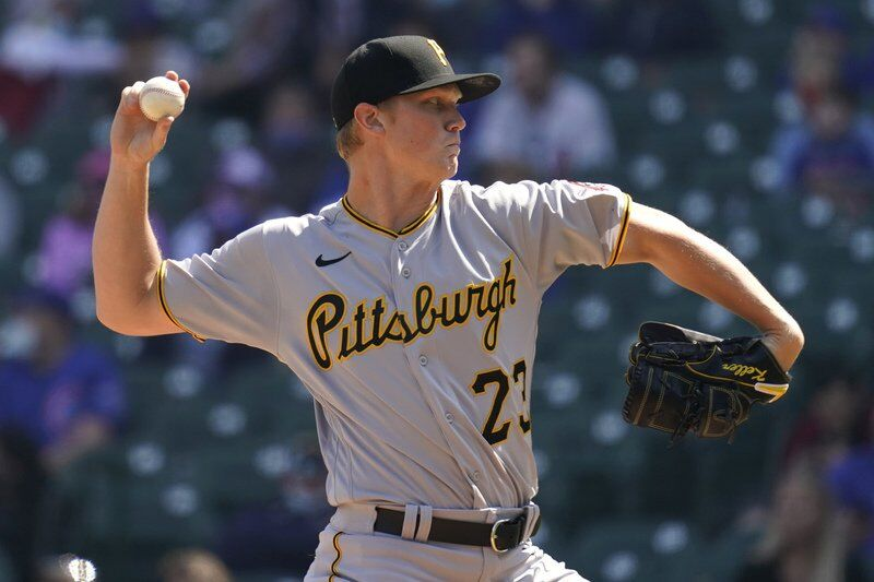 Davies pitches Cubs past Pirates