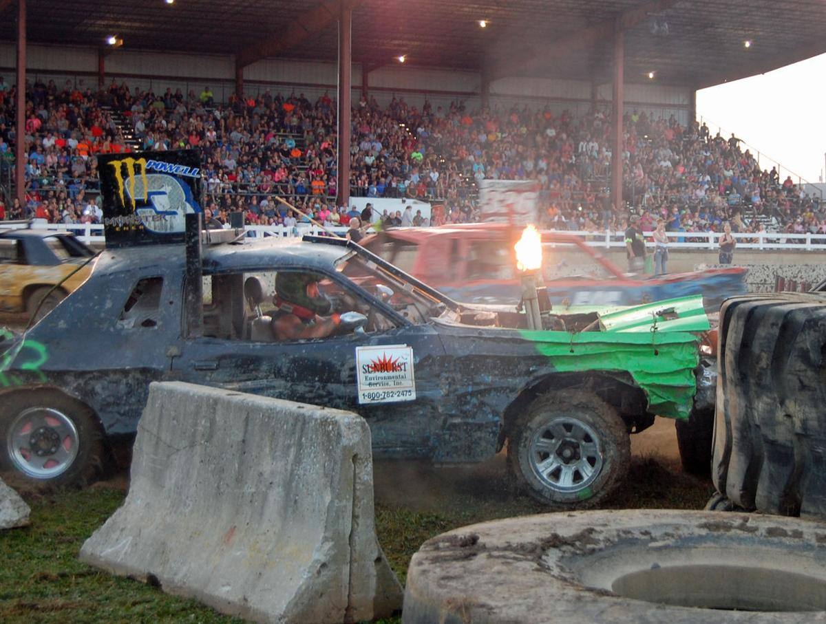 Action from one of the demolition derby s events on the final night of the lawrence county fair