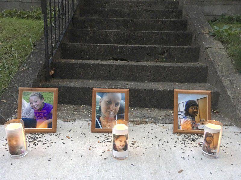 Candlelight vigil honors triple homicide victims