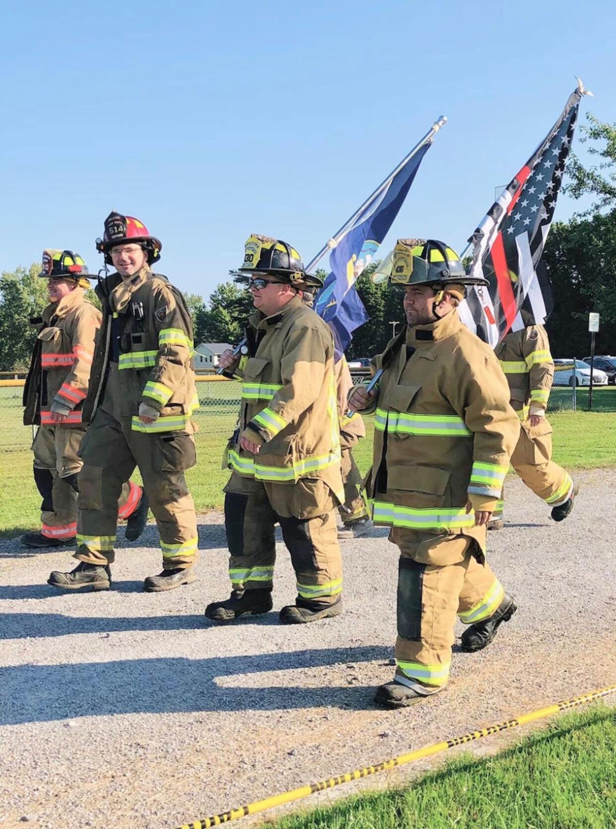 Firefighters walk
