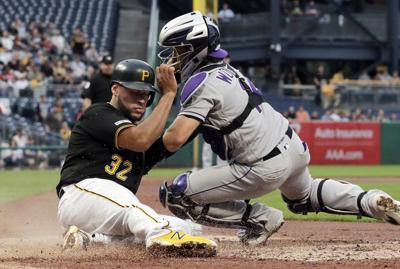 Bell's splash HR not enough; Rockies cruise past Pirates