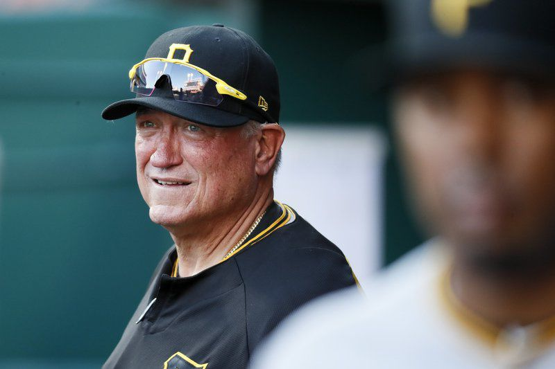 Harrison's triple in 12th sends Pirates over Reds