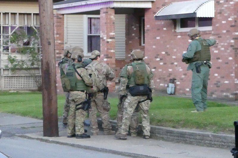 Two dead in triple shooting
