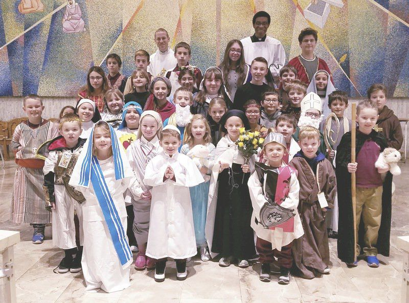 'Saints' participate in holy day Mass