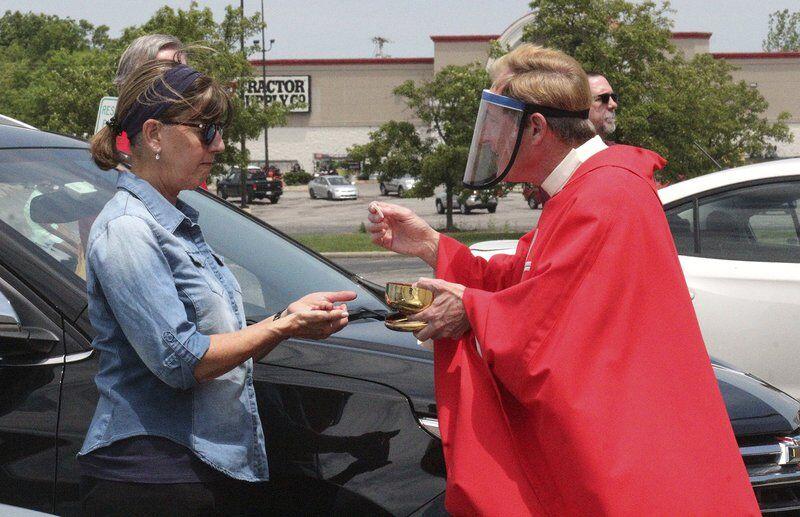 Parish celebrates Mass in former Sears parking lot