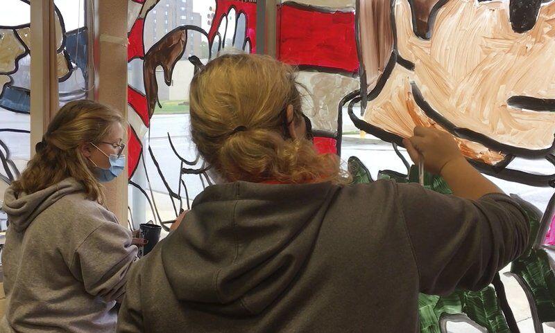 Shenango students paint veterans mural on Legion windows