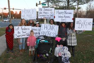 Family brings smiles, joy to Newark intersection for World Kindness Day
