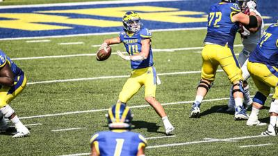 Henderson throws 3 touchdown passes, leads Blue Hens to win in first career start