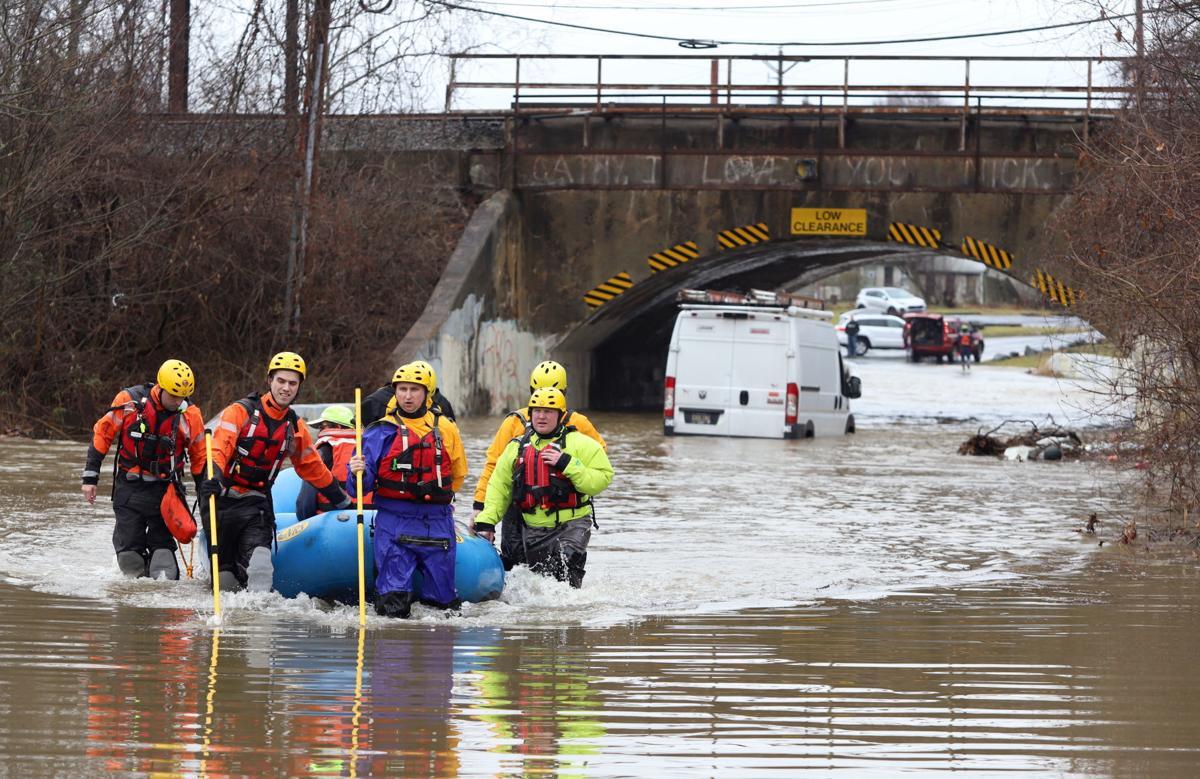 Heavy rain floods roads, strands motorists