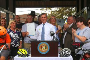 In Newark, Carney signs bicycle safety bills