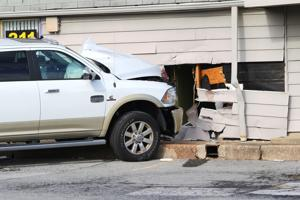 Driver charged with DUI after crashing into Park N Shop building