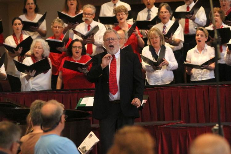 Dr Larkin leading choir and audience.