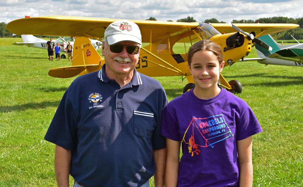 Ralph DeGroodt with new a Young Eagle in front of Ralph's Piper Cub.