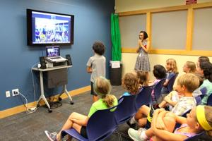 Downes Elementary students practice their Mandarin through video chat with Chinese school