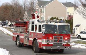 Santa comes to town: In annual tradition, St. Nick gets an assist from Newark fire companies