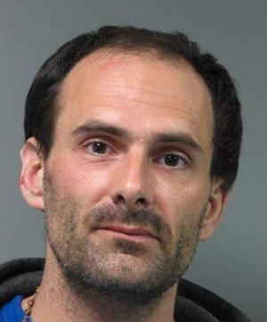 Newark resident interrupts vehicle burglary, detains suspect