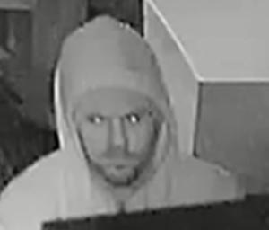 Police seek help identifying Newark Shopping Center burglar