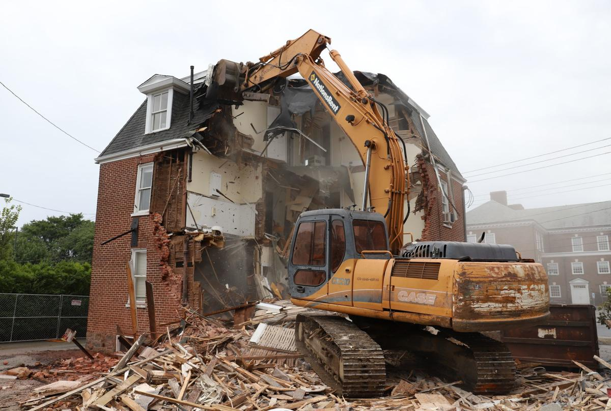 Newark knocks down two old houses to expand parking lot
