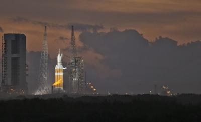 NASA's Orion spacecraft, atop a United Launch Alliance Delta 4-Heavy rocket, sits on the launch pad before its first scheduled unmanned orbital test flight from the Cape Canaveral Air Force Station, Thursday, Dec. 4, 2014, in Cape Canaveral, Florida.